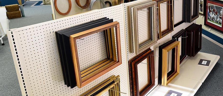 photo of frames hanging in decatur al frame shop pic a frame